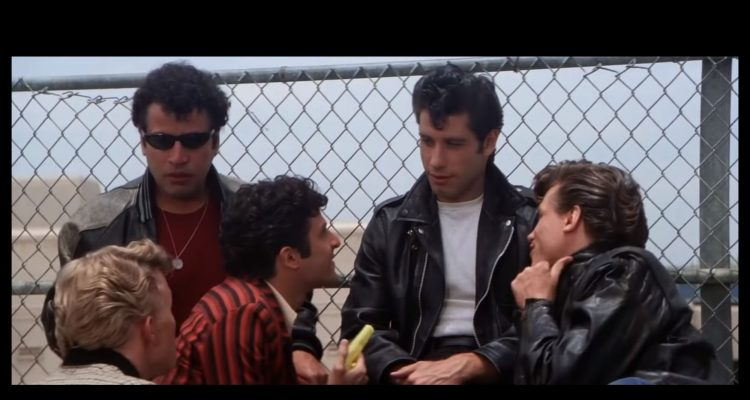 John Travolta and his friends from the film grease wearing stylish clothes