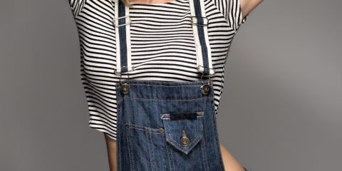 Women wearing denim dungaree's with red lipstick and short crop top