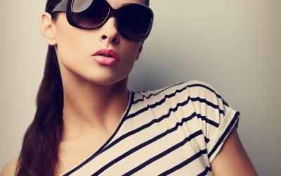 Style beautiful female model in fashion sunglasses. Retro style, nude make up
