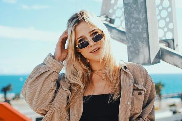Women wearing retro sunglasses and black crop top