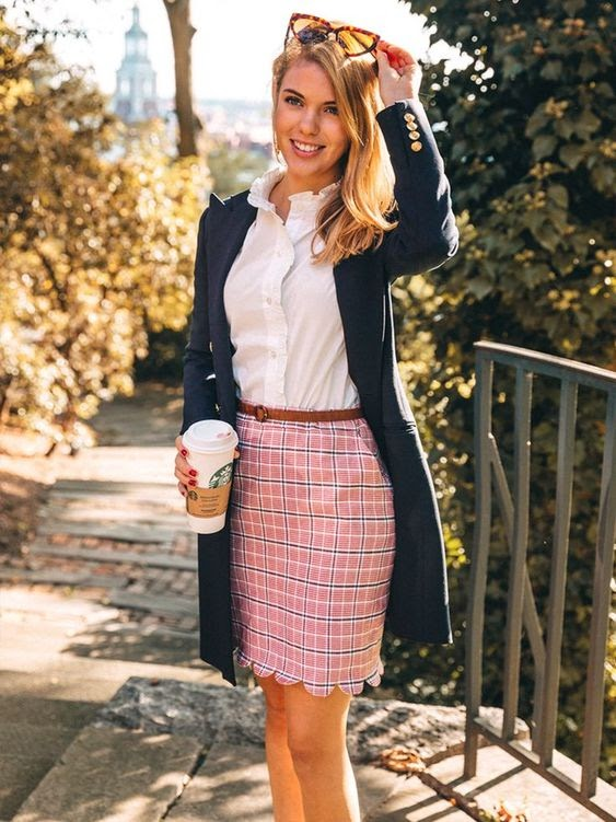 Kiel James Patrick. Women wearing navy blazer, pink tweed skirt and white shirt