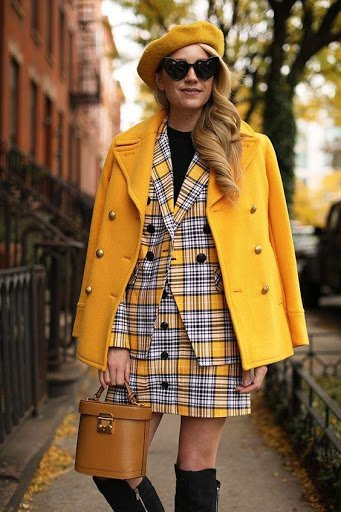 The Atlantic Pacific. Women wearing bold plaid yellow outfit
