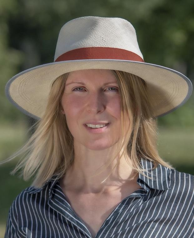 Woman wearing panama straw hat