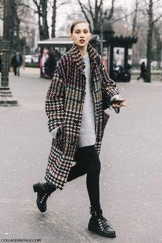 Women wearing checked coat with black tights, black ankle boots and sweater dress