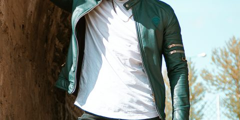 Man wearing leather jacket with skinny black jeans