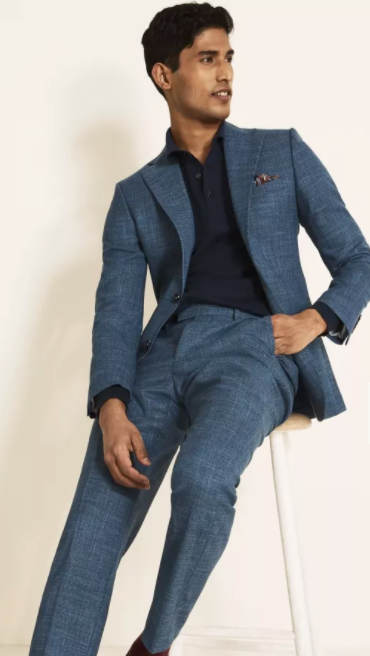 Photo by Moss Bros. (Moss 1851 Tailored Fit Blue Texture Suit)