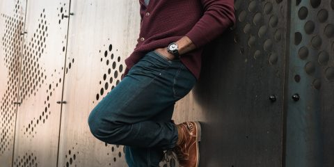 Man wearing a maroon cardigan with skinny jeans and brown boots