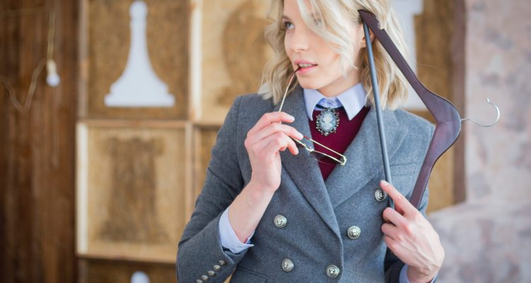 Women wearing a grey blazer and maroon sweater looking very smart, preppy style