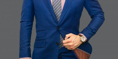 Man wearing blue suit with watch