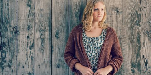 woman wearing a brown cardigan and floral dress