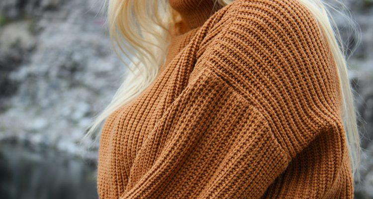 woman wearing a brown pullover turtleneck sweater