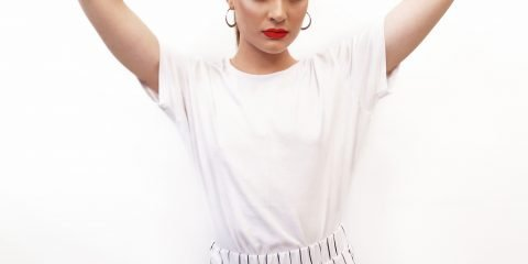 Woman wearing oversize white t-shirt and baggy pants
