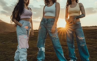 three women wearing baggy jeans