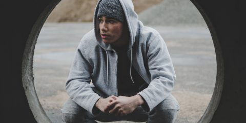 man wearing a grey hoodie and grey sweatpants