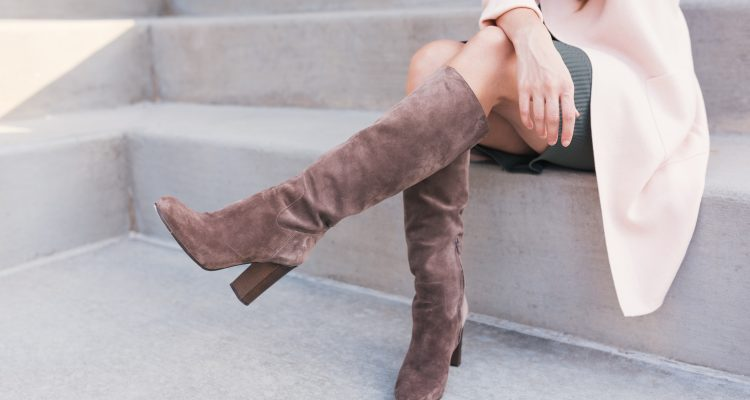 woman wearing knee high boots