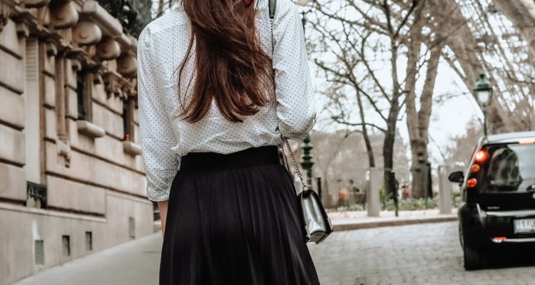 woman wearing Parisian style outfit