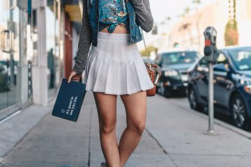 woman wearing a white skater skirt with jacket