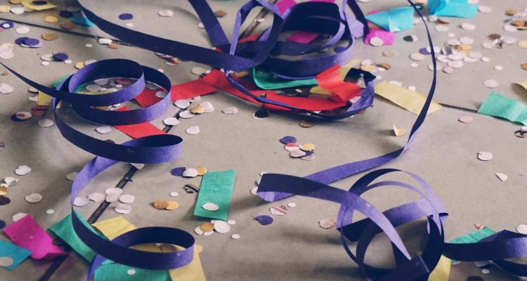 80s party decorations on the floor after a party